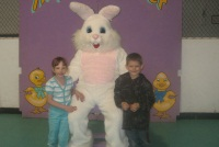 The Easter bunny with two children on his lap