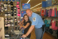 Picture of a police officer and young girl shopping