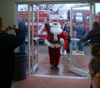 Santa Claus entering a building